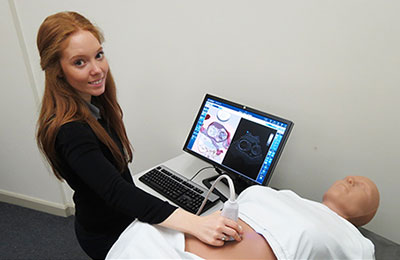 Student using ultrasound simulator.